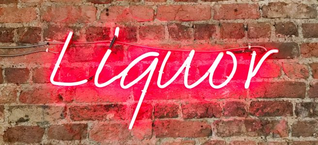Liquor, neon sign, red brick wall,speaking up | See more at www.diywoman.net
