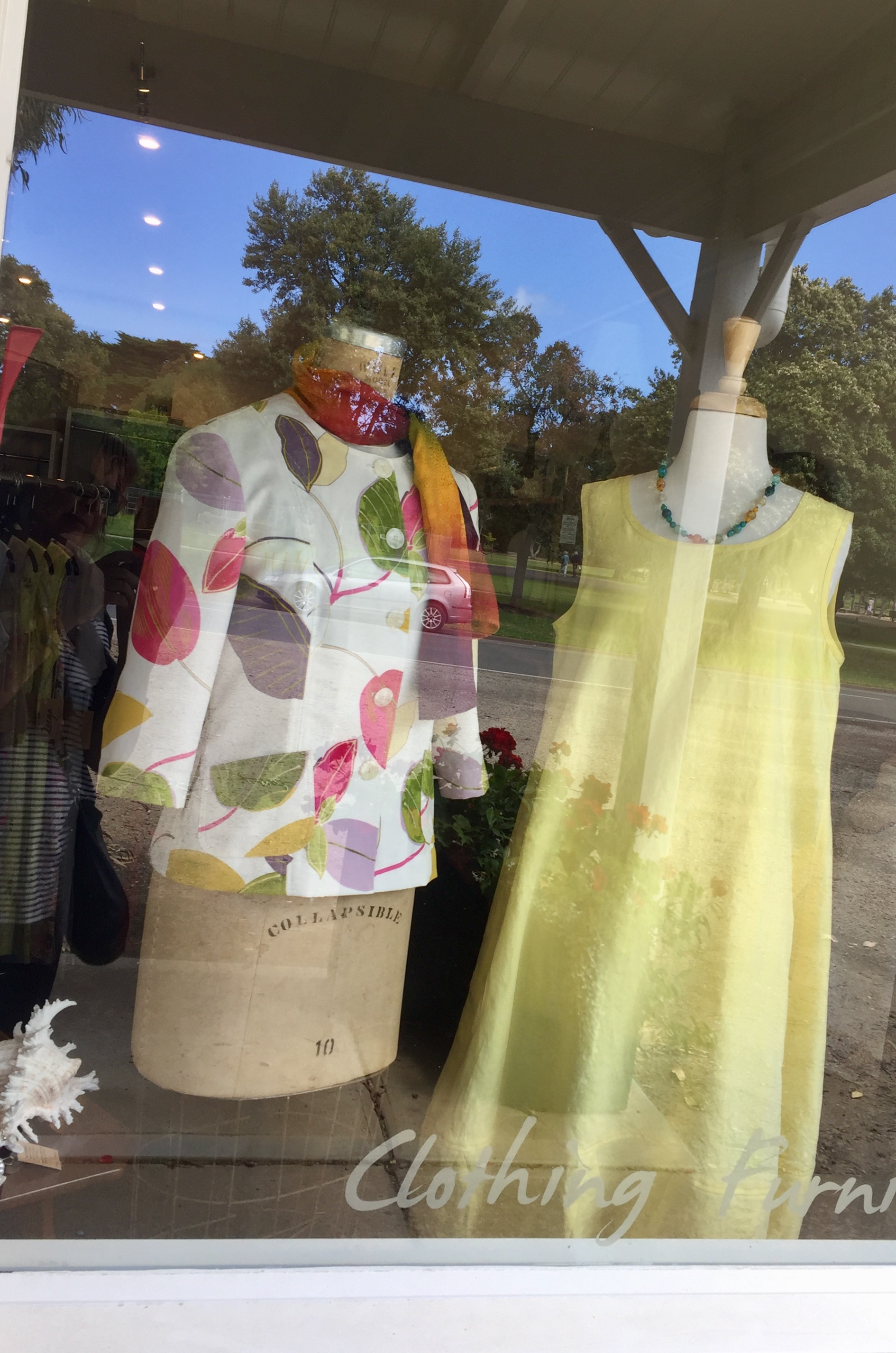Brightly coloured floral jacket in a shop window