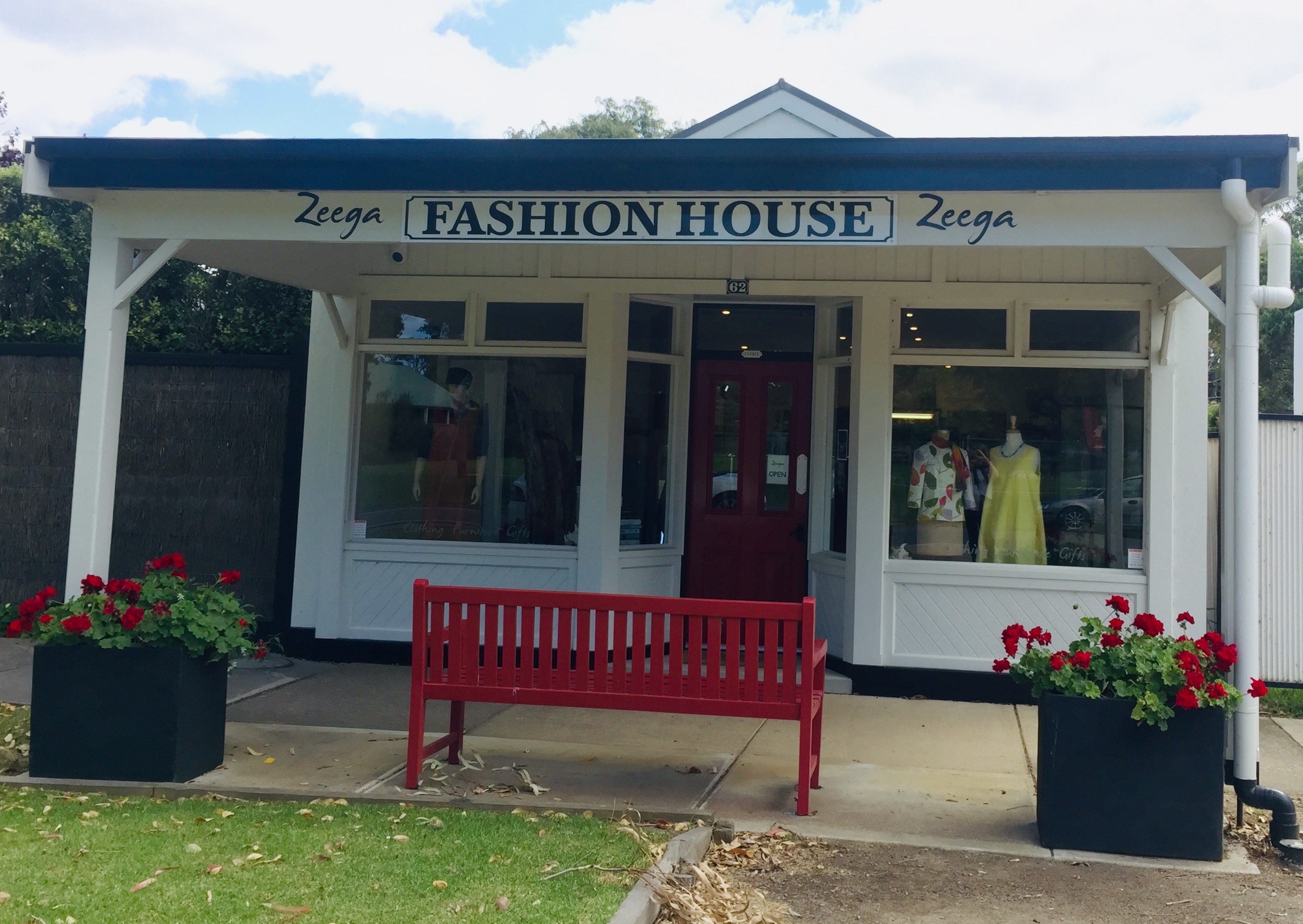 A shopfront with 'Fashion House' written above the window