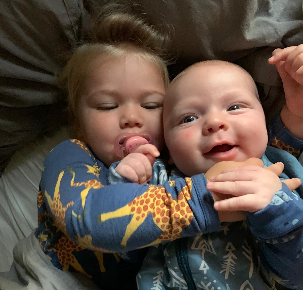 Toddler and baby embracing