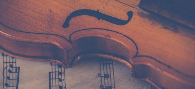 Violin resting on sheet music